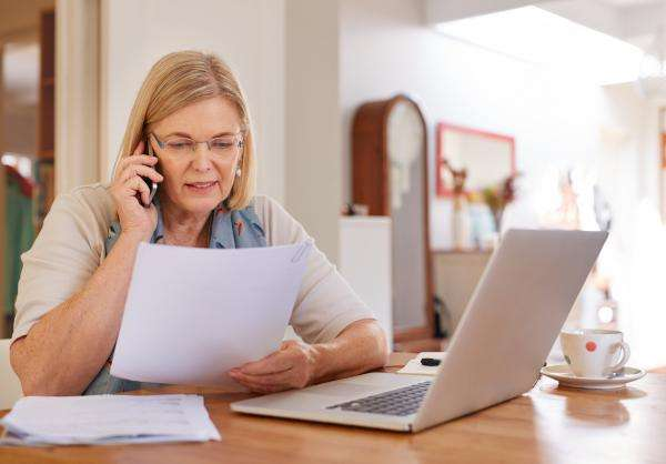Woman researching vision care insurance coverage