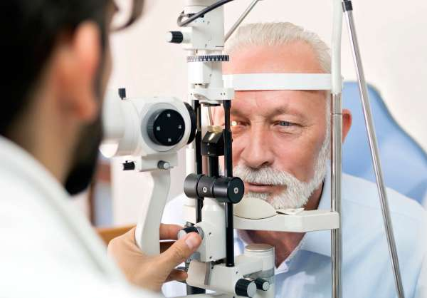 Optometrist checking patient for cataracts