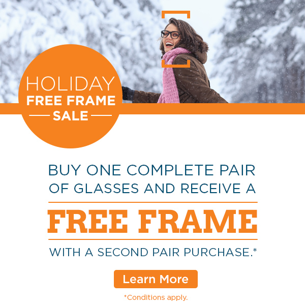 Women wearing eyeglass frames walking in the snow.
